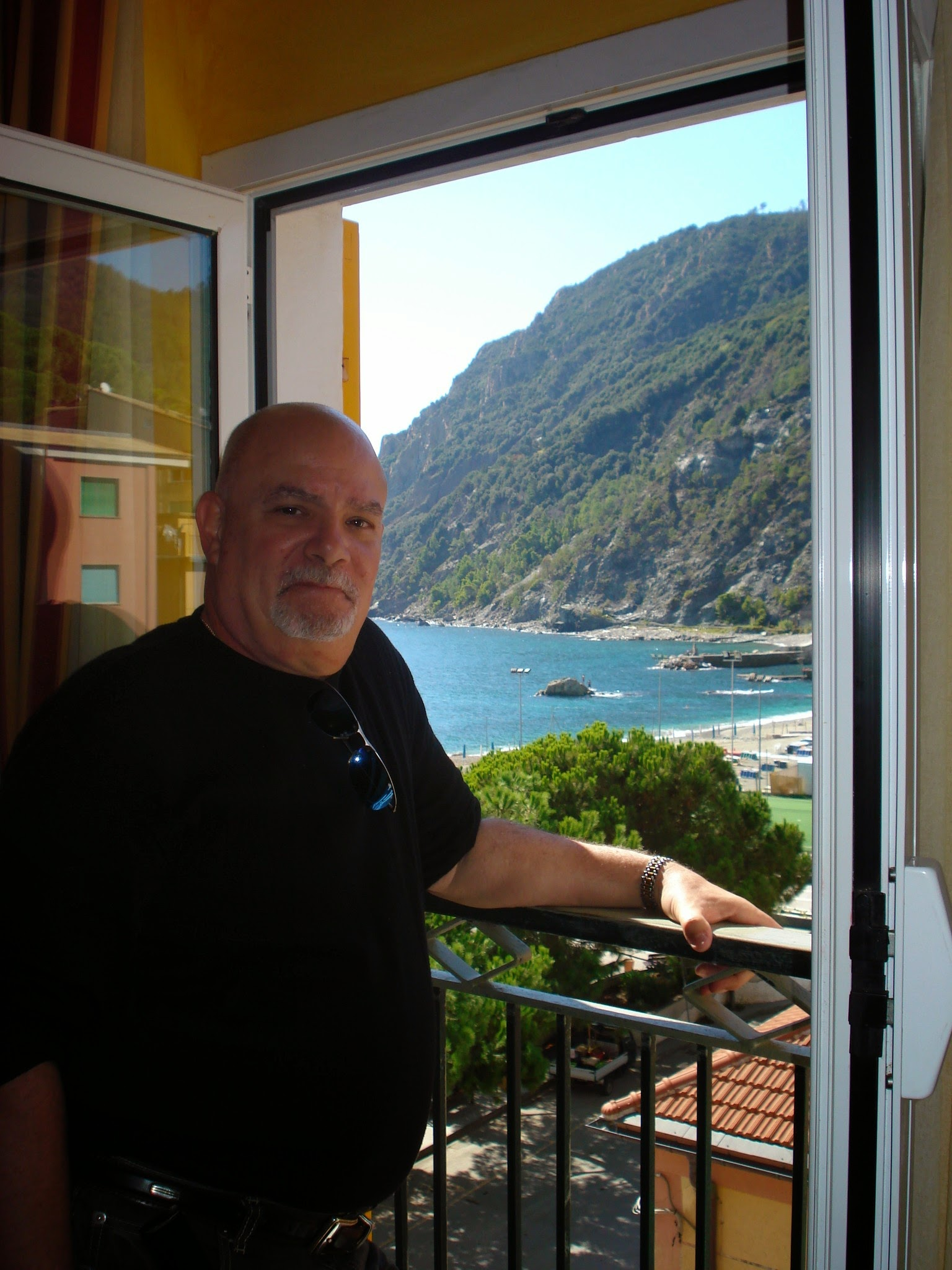 Gary out our window in the hotel in Cinque Terre, Italy. ouritalianjourney.com