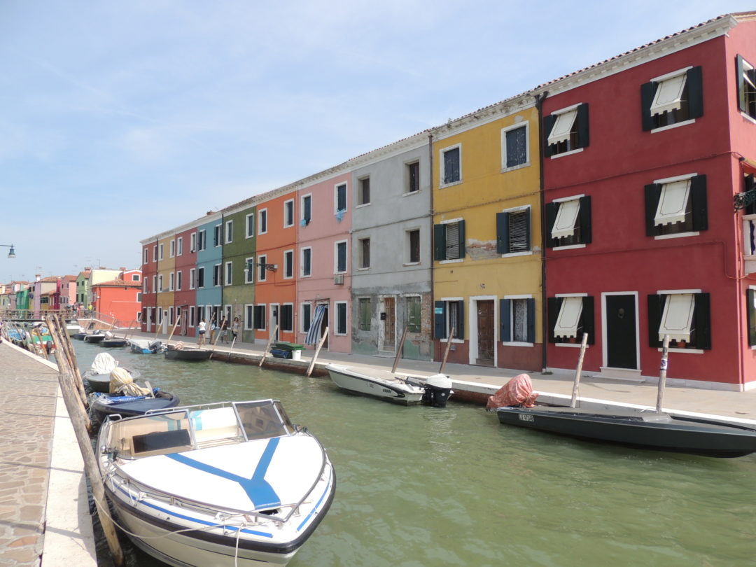 Burano is an island in Venice, Italy; unique colorful homes, ouritalianjourney.com