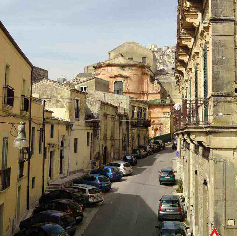 street in Modica, Sicily: Discover the beauty and our funny true story. ouritalianjourney.com
