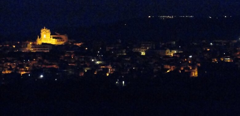 Night photo of Modica, Sicily: Discover the beauty and our funny true story. ouritalianjourney.com