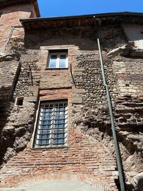 An ancient part of the outside wall of the Anfiteatro in Lucca Centro - ouritalianjourney.com