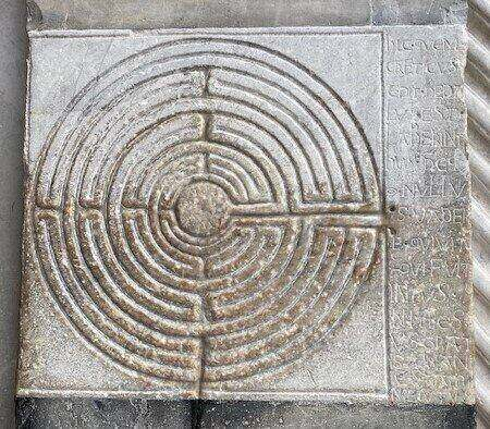 embossed labyrinth on the facade of San Martino in Lucca - ouritalianjourney.com